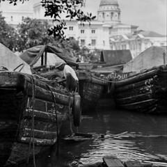 Singapore boatmen (Nikonsnapper) Tags: 1969 mamiya c220 film monochrome river cool singapore uncool boatman cool2 cool3 uncool2 uncool3 uncool4 uncool5 uncool6 uncool7