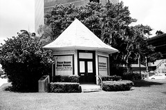Dade County State Bank Building 1893 West Palm Beach (Phillip Pessar) Tags: county camera bw white black west building film beach analog 35mm store state florida zoom kodak