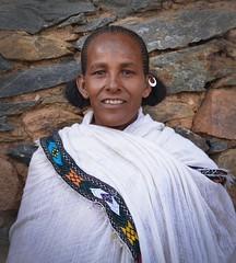 Tigray Traditional, Ethiopia (Rod Waddington) Tags: africa african afrika afrique ethiopia ethiopian ethnic etiopia ethnicity ethiopie thiopien tigray traditional embroidery shamma hairstyle earing stone portrait woman female outdoor people
