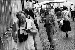 Reading (Roberto Spagnoli) Tags: leggere reading read fotografiadistrada streetphotography biancoenero blackandwhite people canottiera vest libro book