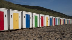 (Lizzie Staley) Tags: color colour beach sunshine seaside rainbow sand dunes huts colourful beachhuts