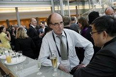 Manfred Breithaupt speaking with a guest at the cocktail reception