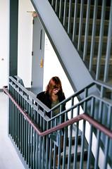 Staircase (101) (Sydney K.) Tags: door red portrait color film girl lines vertical stairs analog 35mm hair glasses stair university pentax kodak arts lewis center iso staircase princeton 100 mm manual railing 35 ektar
