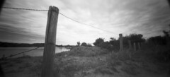 Pinhole fence (Mark Dries) Tags: red holga stock wide wideangle pinhole mgp filter 400iso xtol wpc fomapan 6x12 f135 markguitarphoto markdries