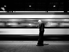 The slow train is coming (Ren Mollet) Tags: basel blackandwhite bw renmollet street streetphotography trainstaion train man move penf bahnhof zug einfahrender
