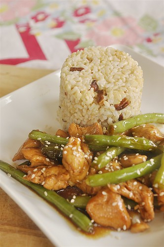 nutty brown rice and string bean chicken on a plate