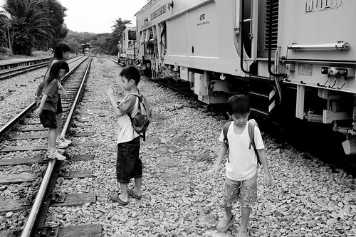 Kids playing alongside a maintenance train at Bukit Timah Railway Station