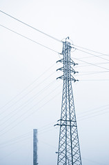 High voltage tower and chimney - Torre elctrica y chimenea (MartinBenito) Tags: morning blue two chimney urban white black cold tower industry blanco lines electric fog azul work high haze energy industrial quiet power y empty pair negro cable calm pylon cables dos wires silence electricity urbana duotone alta lonely electricidad neblina minimalismo calma niebla deserted minimalist voltage torres chimenea fotografa minimalista tranquilidad duotono quietud tensin energa elctrica martinbenito