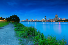 Blue Hour over Boston Skyline and Charles River in Spring, Running Path and Memorial Drive, Cambridge MA (Greg DuBois Photography) Tags: city longexposure nightphotography bridge blue trees cambridge urban usa reflection green water yellow boston skyline architecture night buildings river skyscape photography gold spring twilight cityscape skyscrapers unitedstates dusk path charlesriver newengland wideangle financialdistrict filter esplanade bluehour waterblur prudential backbay harvardbridge cambridgema waterway hancocktower eastcoast cityskyline memorialdrive bostonskyline waterscape greengrass prudentialtower greentrees dirtpath ndfilters runningpath greenbushes gradnd bostonphotographer canon6d gregdubois