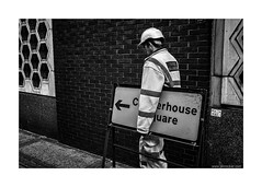 traffic management (jrockar) Tags: street people blackandwhite bw man brick guy london hat sign wall work 35mm lens photography prime mono traffic hard documentary rangefinder management human madness labour fujifilm job carry ordinary diversion ordinarymadness x100s