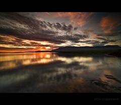 Midnight sun in Iceland (Ptur Gunn Photograpphy) Tags: trip travel sunset sea summer sun mountain reflection june iceland midnight esjan
