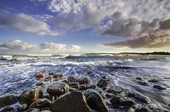 First sun (Nick Twyford) Tags: sea newzealand sky seascape beach water rock clouds sunrise franklin coast nikon rocks surf waterfront auckland filter waikato northisland westcoast portwaikato lee09nd lee12gnd
