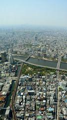 Looking West (iainwalker) Tags: city bridge tower water japan river tokyo canal smog haze horizon structure sumida 2014 skytree tokyoskytree tōkyōsukaitsurī nikond7100