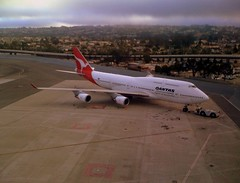 SFO / Qantas 747-400 () Tags: vacation wet fog clouds plane airplane fly inflight airport phone sfo aircraft telephone flight wing jet cellphone cell overcast aerial parked gps aereo 747 airliner avion 747400 iphone airplanewing areo jetwing saofrancisco quantas globalpositioningsystem spiritofaustralia intlairport ario  iphone3g  internationalairport
