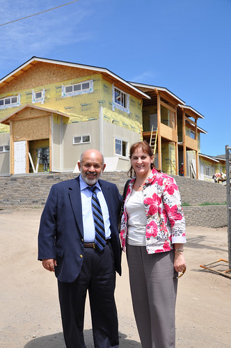 Deputy Undersecretary for Rural Development Victor Vasquez with USDA Rural Development Vicki Walker at the site of a USDA-funded housing facility for central Oregon farm workers.