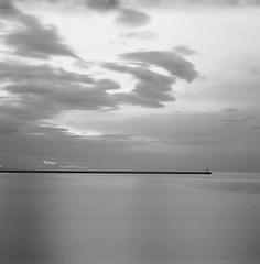 Far n' away (Salt.as) Tags: sea sky bw lighthouse white black 120 6x6 film lines 30 clouds analog port silver photography harbor long exposure kodak tmax minimal f22 100 analogue 90mm kiev vega 6c seconds breakwater ilfosol 12b