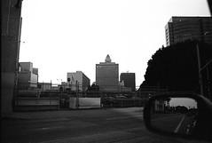 Downtown (bhop) Tags: california blackandwhite bw film 35mm buildings mirror los nikon downtown angeles trix 400 f2 f3 premium ais arista