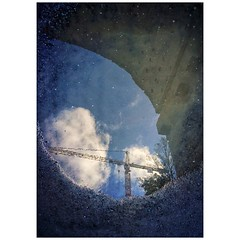 Under the bridge (annaceriksson) Tags: mysthlm stockholm street cloud sky construction reflection puddle bridge