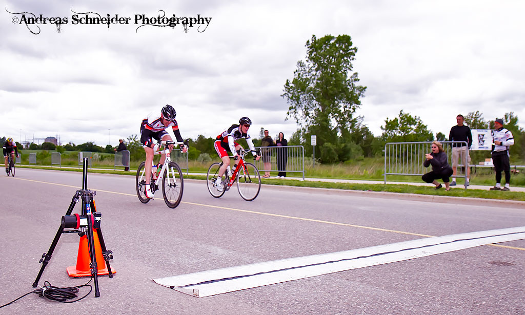Derrek Ivey of Kallisto/Wheels Of Bloor wins the final sprint with Peter Morse of Jet Fuel Coffee/ La Bicicletta for first place in the Elite 1&2 men group in the 2011 K-W Classic Road Race, Ontario C