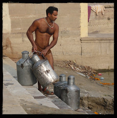 The Milk of Human Kindness (designldg) Tags: people india man male water river square milk atmosphere human soul varanasi jug strength tradition kashi ganga ganges benares benaras ghat milkman uttarpradesh  corporeal indiasong thebestofday gnneniyisi