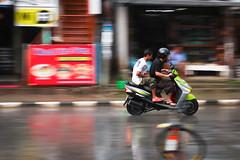 Riding in the rain, Pokhara (neildakeyne) Tags: travel nepal motion reflection wet rain bike canon rebel cycling asia adventure monsoon pokhara t3i 600d dakeyne may2011 canon600d