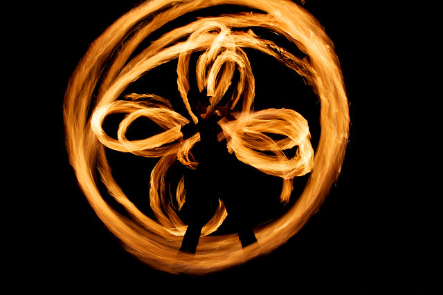 Two fire spinners silhouetted