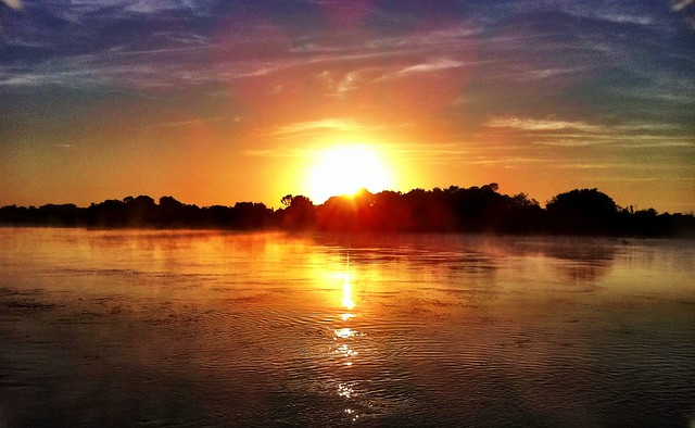 Sun rises over misty Cuiaba river as we head 6 hours down it to heart of Pantanal..