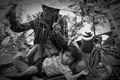 Boat People (nicofaustino_10) Tags: boat people family boy mother river floating village