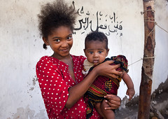 Young Girl With Baby Boy Smling At Camera, Lamu, Kenya (Eric Lafforgue) Tags: africa portrait baby color girl horizontal standing island photography toddler kenya culture unescoworldheritagesite teenager afrika tradition lamu happyface swahili afrique adolescence eastafrica 012months 1617years qunia lamuisland lafforgue traveldestination africanethnicity kenyaafrica mixedraceethnicity muslimislam  smilingsmile qunia  121701   kea 1415years exterioroutdoors   tradingroute blackethnicity a