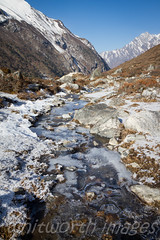 Frozen stream (whitworth images) Tags: morning nepal winter snow mountains cold detail ice nature water beautiful creek landscape frozen nationalpark amazing asia stream pattern stones clean brook flowing himalaya pristine langtang langtangnationalpark kyanjingomba kyanjingumba