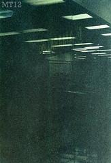 Grainarama (Matthew Trevithick Photography) Tags: ontario reflection london film 35mm dark store downtown december matthew january 2012 dollarama trevithick 2011 mamiyadsx1000 mt12 citiplaza matthewtrevithick mtphotography