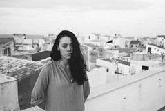 portrait on apartment roof (gorbot.) Tags: sunset blackandwhite dusk rangefinder syracuse sicily mmount leicam8 voigtlander28mmultronf19 vscofilm