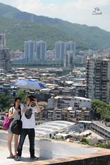Macao (Niccolò Caranti) Tags: china city shadow summer panorama tourism umbrella couple asia photographer estate view ombra vista turismo cina ombrello fotografo città coppia macao dsc8099 nikond700
