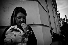 Return to the Nail-Biting Phonecall (stimpsonjake) Tags: nikoncoolpixa 185mm streetphotography bucharest romania city candid blackandwhite bw monochrome girl phone phonecall nervous emotional stressful woman
