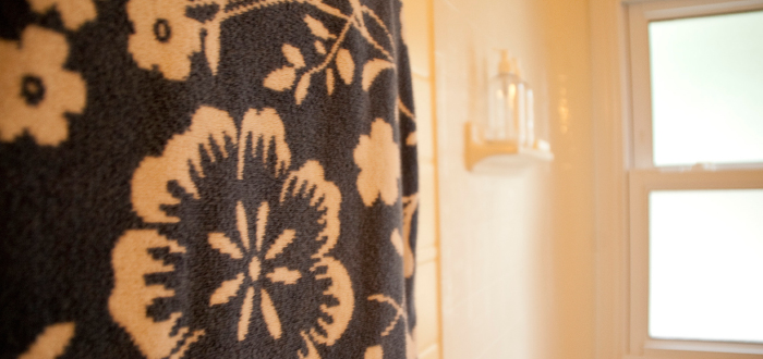 dash dot dotty dashdotdotty house tour interiors tan comfortable modern bathroom towels blue print target