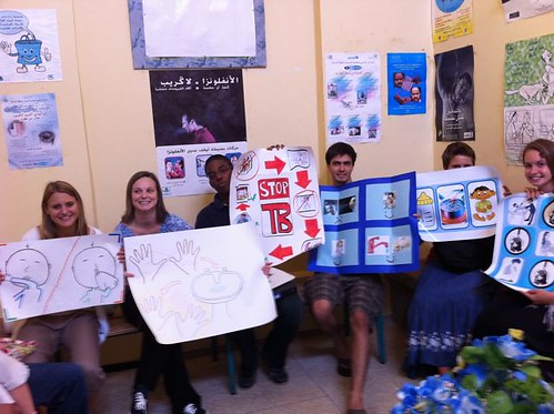 Students holding Helath Posters at Health Clinic