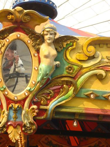self-portrait in a carousel