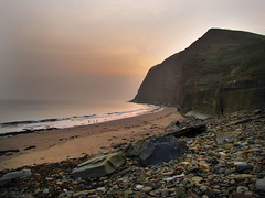 Breaking through. (paul downing) Tags: beach misty sunrise canon spring cliffs pdp skinningrove coastaluk pd1001 sx10is pauldowning