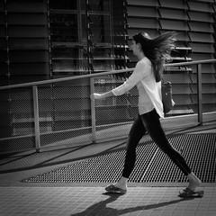 hair, grid & lines (reto.aerni) Tags: tore agbar girl bw street barcelona hair wind fast