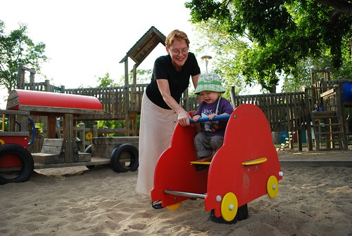 Mom and Colin on the rocking car