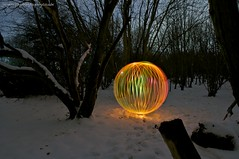 woods and snow (~ jules ~) Tags: longexposure light red snow lightpainting tree green yellow night ball orb sphere lightpaint