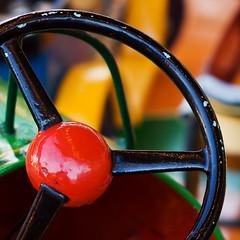 New set of wheels (Simon Caplan) Tags: red orange black green wheel metal docks bristol fairground multicoloured multicolored funfair harbourside bristolharbour carterssteamfair bristoldocks fairgroundrides funfairs bristoluk bristolharbourside bristolengland anchorsquare