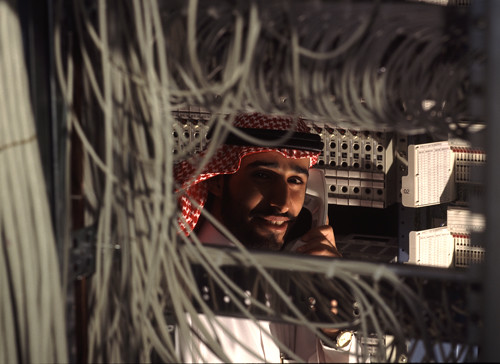 Technician in telephone switch room, Riyadh, Saudi Arabia.