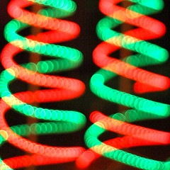 Christmas DNA (kevin dooley) Tags: christmas xmas light red color green canon spiral fun eos 50mm colorful cheery bokeh f14 pair 14 vivid twin dna strings stands hohoho christmaslight xmaslight 40d dnaspiral