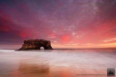 Firestorm - Natural Bridges State Park, California (david.richter) Tags: ocean california statepark pink sunset red summer orange usa santacruz seascape fall monument nature water northerncalifornia canon wonder landscape fun eos rebel twilight raw waves pacific outdoor dusk hiking unitedstatesofamerica hike adventure story norcal polarizer happyholidays merrychristmas rare circular graduated naturalbridges manfrotto kalifornien xsi feliznavidad rushing happydance giottos gnd goldencoast froheweihnachten rainshowers singleexposure godjul ishootraw nohdr davidrichter singhray 450d nofog aftersundown bonnoel gradualneutraldensityfilter northofbigsur wwwdavidrichterphotographycom nomarinelayer