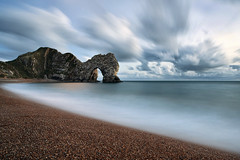 Durdle Door (peterspencer49) Tags: ocean door uk greatbritain winter water clouds bay movement waves arch unitedkingdom britain pebbles unesco worldheritagesite dorset coastline oceanview seamist coastalpath durdle southwestcoast durdledoor stonearch jurassiccoast dorsetcoast southwestcoastalpath top20longexposure stunningview seascene oceanveiw limestonearch cliffwalks 5dmkll peterspencer stunningseascape peterspencer49