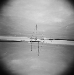 Sky in the water (MikeSkelton01) Tags: sky white black film water monochrome grass clouds boat holga lomo lomography pole xp2 400 sail mast asa ilford 120n