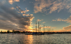 As the sun sets on a Danish summer (andyputnam) Tags: ocean sunset sea summer orange color reflection andy water clouds sailboat marina canon copenhagen denmark gold coast boat europe seasons dusk wideangle mast ultrawide hdr xsi putnam 10mm andyputnam