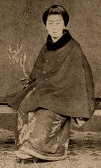 Geiko Kayo - wearing a Fur-trimmed Cape 1870s (Blue Ruin1) Tags: leaves japan sepia bench carpet japanese kyoto branch sitting trimmed famous geiko geisha cape cdv cartedevisite kimono cloak gion trimming popular seated geta noted luckybamboo wellknown renown kanzashi doublebreasted furcollar tamakan coralbead albumenphotograph fukuzasa erakayo earlymeijiperiod