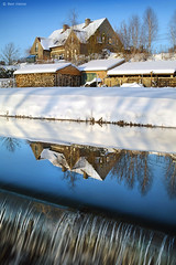 Little House near the Waterfall (Ben Heine) Tags: blue winter light wallpaper white inspiration snow cold reflection art home nature beauty silhouette architecture photography hope freedom evening countryside canal waterfall scenery energy die afternoon belgium belgique belgie image lumière live air hiver sneeuw arts dream picture peaceful atmosphere oxygen together liberté freeze serenity series snowing neige minimalism conceptual tomorrow maison cascade arbre froid imagery ecosystem hibernation vibration waterscape littlehouse workflow luminosity platteland postprocessing theartistery snieg platpays creativecomposition benheine braives flickrunited samsungimaging nx10 benheinecom